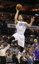 Dec 17, 2013; Charlotte, NC, USA; Charlotte Bobcats forward forward Josh McRoberts (11) drives to the basket and shoots during the second half of the game against the Sacramento Kings at Time Warner Cable Arena.  Bobcats win 95-87.  Mandatory Credit: Sam Sharpe-USA TODAY Sports