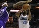 Dec 17, 2013; Charlotte, NC, USA; Charlotte Bobcats center Al Jefferson (25) shoots as he is defended by Sacramento Kings center DeMarcus Cousins (15) during the second half of the game at Time Warner Cable Arena. Bobcats win 95-87. Mandatory Credit: Sam Sharpe-USA TODAY Sports