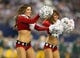 Dec 15, 2013; Arlington, TX, USA; Dallas Cowboys cheerleader performs at halftime in holiday outfits against the Green Bay Packers at AT&T Stadium. Mandatory Credit: Matthew Emmons-USA TODAY Sports