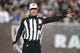 Dec 15, 2013; Oakland, CA, USA; NFL referee Clete Blakeman calls a penalty during the game between the Kansas City Chiefs and the Oakland Raiders at O.co Coliseum. The Chiefs defeated the Raiders 56-31. Mandatory Credit: Kirby Lee-USA TODAY Sports