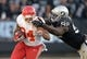 Dec 15, 2013; Oakland, CA, USA; Kansas City Chiefs running back Knile Davis (34) is pursued by Oakland Raiders defensive tackle Stacy McGee (92) at O.co Coliseum. The Chiefs defeated the Raiders 56-31. Mandatory Credit: Kirby Lee-USA TODAY Sports
