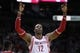 Dec 18, 2013; Houston, TX, USA; Houston Rockets power forward Dwight Howard (12) reacts to a play during the second quarter against the Chicago Bulls at Toyota Center. Mandatory Credit: Andrew Richardson-USA TODAY Sports