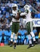 Dec 15, 2013; Charlotte, NC, USA; New York Jets outside linebacker Calvin Pace (97) and free safety Antonio Allen (39) react in the first quarter at Bank of America Stadium. Mandatory Credit: Bob Donnan-USA TODAY Sports