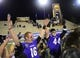 Dec 20, 2013; Salem, VA, USA; UW-Whitewater quarterback Matt Behrendt (16) and linebacker Cole Klotz (44) celebrate with the championship trophy. UW-Whitewater defeated Mount Union Purple Raiders 52-14 at Salem Stadium. Mandatory Credit: Bob Donnan-USA TODAY Sports