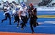Dec 21, 2013; Boise, ID, USA; San Diego State Aztecs running back Adam Muema (4) runs past Buffalo Bulls linebacker Jake Stockman (9) during the first half of the Idaho Potato Bowl at Bronco Stadium. Mandatory Credit: Brian Losness-USA TODAY Sports
