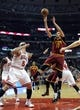 Dec 21, 2013; Chicago, IL, USA; Cleveland Cavaliers center Anderson Varejao (17) shoots over Chicago Bulls power forward Carlos Boozer (5) during the first quarter at the United Center. Mandatory Credit: David Banks-USA TODAY Sports