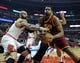 Dec 21, 2013; Chicago, IL, USA; Cleveland Cavaliers center Andrew Bynum (21) is defended by Chicago Bulls power forward Carlos Boozer (5) during the first quarter at the United Center. Mandatory Credit: David Banks-USA TODAY Sports