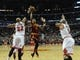 Dec 21, 2013; Chicago, IL, USA; Cleveland Cavaliers point guard Jarrett Jack (1) shoots over Chicago Bulls power forward Taj Gibson (22) and power forward Carlos Boozer (5) during the first quarter at the United Center. Mandatory Credit: David Banks-USA TODAY Sports