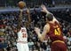 Dec 21, 2013; Chicago, IL, USA;  Chicago Bulls small forward Tony Snell (20) shoots over Cleveland Cavaliers center Tyler Zeller (40) during the second half at the United Center. T'he Chicago Bulls defeated the Cleveland Cavaliers 100-84. Mandatory Credit: David Banks-USA TODAY Sports