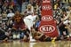 Dec 21, 2013; Chicago, IL, USA; Cleveland Cavaliers point guard Jarrett Jack (bottom) and Chicago Bulls small forward Tony Snell (20) go for a loose ball during the second half at the United Center. T'he Chicago Bulls defeated the Cleveland Cavaliers 100-84. Mandatory Credit: David Banks-USA TODAY Sports