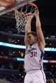 Dec 21, 2013; Los Angeles, CA, USA;  Los Angeles Clippers power forward Blake Griffin (32) hangs on the rim in the second half of the game against the Denver Nuggets at Staples Center. The Clippers won 112-91. Mandatory Credit: Jayne Kamin-Oncea-USA TODAY Sports