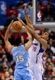 Dec 21, 2013; Los Angeles, CA, USA;  Los Angeles Clippers center Ryan Hollins (15) blocks a shot by Denver Nuggets small forward Anthony Randolph (15) in the second half of the game at Staples Center. The Clippers won 112-91. Mandatory Credit: Jayne Kamin-Oncea-USA TODAY Sports