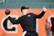 Dec 8, 2013; Cincinnati, OH, USA; Cincinnati Bengals quarterback Andy Dalton (14) warms up before the game against the Minnesota Vikings at Paul Brown Stadium. Mandatory Credit: Marc Lebryk-USA TODAY Sports