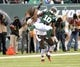 Dec 22, 2013; East Rutherford, NJ, USA; Cleveland Browns cornerback Leon McFadden (29) breaks up a pass intended for New York Jets wide receiver Santonio Holmes (10) during the game at MetLife Stadium. Mandatory Credit: Robert Deutsch-USA TODAY Sports