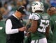 Dec 22, 2013; East Rutherford, NJ, USA; New York Jets head coach Rex Ryan speaks with inside linebacker David Harris (52) during the second half against the Cleveland Browns at MetLife Stadium.  The Jets defeated the Browns 24-13.  Mandatory Credit: Ed Mulholland-USA TODAY Sports