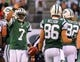 Dec 22, 2013; East Rutherford, NJ, USA; New York Jets quarterback Geno Smith (7) and wide receiver David Nelson (86) celebrate the Jets 42-13 win over the Cleveland Browns at MetLife Stadium.  Mandatory Credit: Ed Mulholland-USA TODAY Sports
