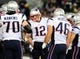 Dec 22, 2013; Baltimore, MD, USA; New England Patriots quarterback Tom Brady (12) talks to his teammates in the huddle during the game against the Baltimore Ravens at M&T Bank Stadium. Mandatory Credit: Evan Habeeb-USA TODAY Sports