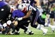 Dec 22, 2013; Baltimore, MD, USA; Baltimore Ravens quarterback Joe Flacco (5) is sacked by New England Patriots defensive end Chandler Jones (95) at M&T Bank Stadium. Mandatory Credit: Evan Habeeb-USA TODAY Sports