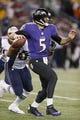 Dec 22, 2013; Baltimore, MD, USA; Baltimore Ravens quarterback Joe Flacco (5) pressured by the New England Patriots defense at M&T Bank Stadium. Mandatory Credit: Mitch Stringer-USA TODAY Sports