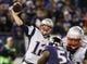Dec 22, 2013; Baltimore, MD, USA; New England Patriots quarterback Tom Brady (12) passes against the Baltimore Ravens at M&T Bank Stadium. Mandatory Credit: Mitch Stringer-USA TODAY Sports