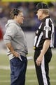 Dec 22, 2013; Baltimore, MD, USA; New England Patriots head coach Bill Belichick has a call during the game against the Baltimore Ravens explained by field judge Scott Steenson (88) at M&T Bank Stadium. Mandatory Credit: Mitch Stringer-USA TODAY Sports