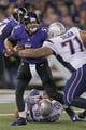 Dec 22, 2013; Baltimore, MD, USA; Baltimore Ravens quarterback Joe Flacco (5) sacked by New England Patriots tackle Seaver Siliga (71) at M&T Bank Stadium. Mandatory Credit: Mitch Stringer-USA TODAY Sports