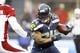 Dec 22, 2013; Seattle, WA, USA; Seattle Seahawks running back Marshawn Lynch (24) rushes against the Arizona Cardinals during the third quarter at CenturyLink Field. Mandatory Credit: Joe Nicholson-USA TODAY Sports