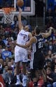 Dec 16, 2013; Los Angeles, CA, USA; Los Angeles Clippers forward Jared Dudley (9) is defended by San Antonio Spurs forward Tim Duncan (21) at Staples Center. The Clippers defeated the Spurs 115-92. Mandatory Credit: Kirby Lee-USA TODAY Sports