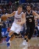 Dec 16, 2013; Los Angeles, CA, USA; Los Angeles Clippers forward Blake Griffin (32) is defended by San Antonio Spurs guard Marco Belinelli (3) at Staples Center. Mandatory Credit: Kirby Lee-USA TODAY Sports