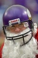 Dec 15, 2013; Minneapolis, MN, USA; John Norwood of Norwood, Ohio dressed as Santa and gets ready for the Minnesota Vikings to play the Philadelphia Eagles at Mall of America Field at H.H.H. Metrodome. The Vikings win 48-30. Mandatory Credit: Bruce Kluckhohn-USA TODAY Sports