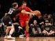 Dec 25, 2013; Brooklyn, NY, USA;  Brooklyn Nets power forward Mirza Teletovic (33) defends Chicago Bulls center Joakim Noah (13) during the third quarter at Barclays Center. Chicago Bulls won 95-78.  Mandatory Credit: Anthony Gruppuso-USA TODAY Sports