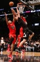 Dec 25, 2013; Brooklyn, NY, USA;  Brooklyn Nets power forward Mason Plumlee (1) is fouled at the net by Chicago Bulls center Joakim Noah (13) during the fourth quarter at Barclays Center. Chicago Bulls won 95-78.  Mandatory Credit: Anthony Gruppuso-USA TODAY Sports