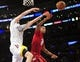 December 25, 2013; Los Angeles, CA, USA; Los Angeles Lakers power forward Ryan Kelly (4) is fouled on a scoring play by Miami Heat power forward Rashard Lewis (9) during the second half at Staples Center. Mandatory Credit: Gary A. Vasquez-USA TODAY Sports
