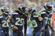 Dec 22, 2013; Seattle, WA, USA; Seattle Seahawks cornerback Richard Sherman (25) and free safety Earl Thomas (29) celebrate after Sherman intercepted the ball thrown by Arizona Cardinals quarterback Carson Palmer (not pictured) during the game at CenturyLink Field. Arizona defeated Seattle 17-10. Mandatory Credit: Steven Bisig-USA TODAY Sports