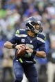 Dec 22, 2013; Seattle, WA, USA; Seattle Seahawks quarterback Russell Wilson (3) looks to pass during the game against the Arizona Cardinals at CenturyLink Field. Arizona defeated Seattle 17-10. Mandatory Credit: Steven Bisig-USA TODAY Sports