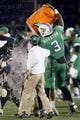 Dec 27, 2013; Annapolis, MD, USA; Marshall Thundering Herd head coach Doc Holliday is doused with Gatorade by linebacker Stefan Houston (3) in the closing minutes of the game against the Maryland Terrapins during the 2013 Military Bowl at Navy-Marine Corps Memorial Stadium. Mandatory Credit: Mitch Stringer-USA TODAY Sports