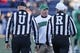 Dec 27, 2013; Annapolis, MD, USA; Marshall Herd head coach Doc Holliday questions umpire Tab Slaughter and referee Dan Romeo during the game against the Maryland Terrapins during the 2013 Military Bowl at Navy-Marine Corps Memorial Stadium. Mandatory Credit: Mitch Stringer-USA TODAY Sports