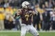 Dec 27, 2013; Houston, TX, USA; Minnesota Golden Gophers quarterback Mitch Leidner (7) looks for an open receiver during the second quarter of the Texas Bowl against the Syracuse Orange at Reliant Stadium . Mandatory Credit: Troy Taormina-USA TODAY Sports