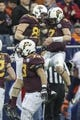 Dec 27, 2013; Houston, TX, USA; Minnesota Golden Gophers tight end Maxx Williams (88) and quarterback Mitch Leidner (7) celebrate after Williams scores a touchdown during the fourth quarter of the Texas Bowl against the Syracuse Orange at Reliant Stadium . Mandatory Credit: Troy Taormina-USA TODAY Sports