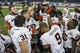 Dec 27, 2013; Houston, TX, USA; Members of the Syracuse Orange hold the Texas Bowl trophy after defeating the Minnesota Golden Gophers 21-17 at Reliant Stadium . Mandatory Credit: Troy Taormina-USA TODAY Sports