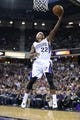 Dec 27, 2013; Sacramento, CA, USA; Sacramento Kings point guard Isaiah Thomas (22) scores a layup against the Miami Heat during the third quarter at Sleep Train Arena. The Sacramento Kings defeated the Miami Heat 108-103 in overtime. Mandatory Credit: Kelley L Cox-USA TODAY Sports