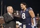 Dec 27, 2013; San Francisco, CA, USA; Washington Huskies defensive end Hau'oli Kikaha (8) accepts the outstanding defensive player of the game award after defeating the Brigham Young Cougars 31-16 at AT&T Park. Mandatory Credit: Ed Szczepanski-USA TODAY Sports