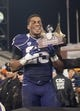 Dec 27, 2013; San Francisco, CA, USA; Washington Huskies running back Bishop Sankey (25) holds up the outstanding offensive player of the game award after defeating the Brigham Young Cougars 31-16 at AT&T Park. Mandatory Credit: Ed Szczepanski-USA TODAY Sports