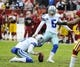 Dec 22, 2013; Landover, MD, USA; Dallas Cowboys place kicker Dan Bailey (5) kicks an extra point against the Washington Redskins during the first half at FedEx Field. Mandatory Credit: Brad Mills-USA TODAY Sports