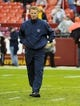 Dec 22, 2013; Landover, MD, USA; Dallas Cowboys head coach Jason Garrett on the field before the game against the Washington Redskins at FedEx Field. Mandatory Credit: Brad Mills-USA TODAY Sports