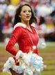 Dec 22, 2013; Landover, MD, USA; Washington Redskins cheerleaders on the field against the Dallas Cowboys during the first half at FedEx Field. Mandatory Credit: Brad Mills-USA TODAY Sports