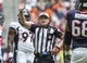 Dec 22, 2013; Houston, TX, USA; NFL referee Ed Hochuli (85) makes a call during the second quarter during a game between the Houston Texans and the Denver Broncos at Reliant Stadium. Mandatory Credit: Troy Taormina-USA TODAY Sports