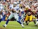 Dec 22, 2013; Landover, MD, USA; Dallas Cowboys quarterback Tony Romo (9) drops back to pass as Washington Redskins linebacker Brian Orakpo (98) rushes during the first half at FedEx Field. Mandatory Credit: Brad Mills-USA TODAY Sports