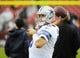 Dec 22, 2013; Landover, MD, USA; Dallas Cowboys quarterback Tony Romo (9) warms up before the game against the Washington Redskins at FedEx Field. Mandatory Credit: Brad Mills-USA TODAY Sports
