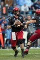 Dec 28, 2013; Charlotte, NC, USA; Cincinnati Bearcats quarterback Brendon Kay (11) looks to pass the ball during the second quarter against the North Carolina Tar Heels at Bank of America Stadium. Mandatory Credit: Jeremy Brevard-USA TODAY Sports